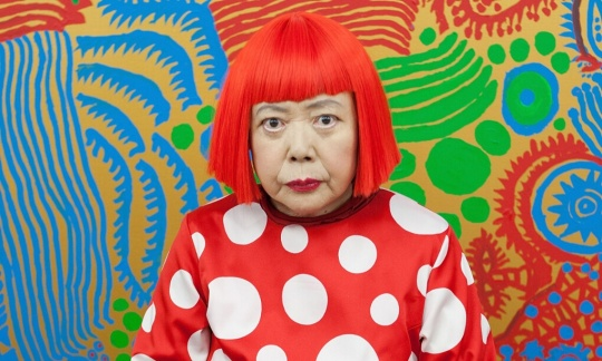 Yayoi Kusama sits in front of one of her newly finished paintings in her studio. Photograph: Jeremy Sutton-Hibbert/Getty Images